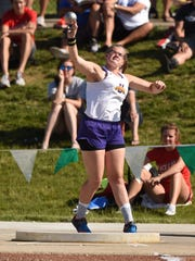Unioto's Autumn Mohan throws the shot put during the