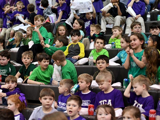Trinity Christian Academy students dressed up in green