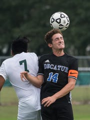 Decatur's Alton Walker (14) takes a header while Parkside's