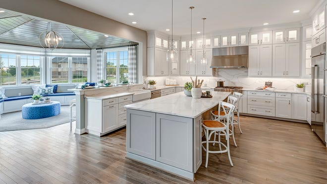 Extending cabinetry to the ceiling with lighting adds drama and function.