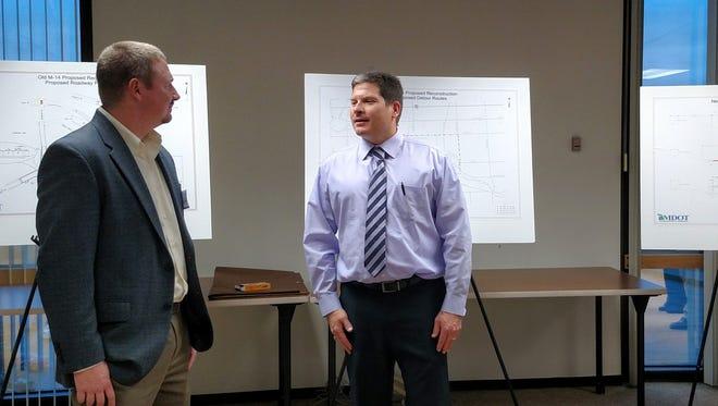 MDOT engineer Adam Penzenstadler speaks with Livonia city engineer Todd Zilincik Thursday at Livonia City Hall.
