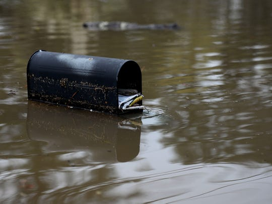 A mail box is covered by flood waters on Dianne Street.