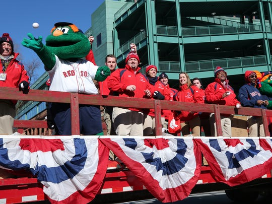 At Fenway Park fans and others gathered for a send off of the Red Sox equipment truck as it leaves for JetBlue Park in Fort Myers.