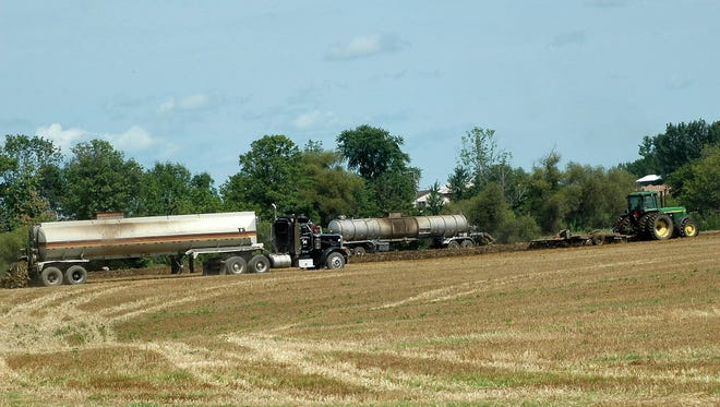 Multiple pieces of equipment made for speedy application and incorporation of nutrients on a field near Manitowoc.