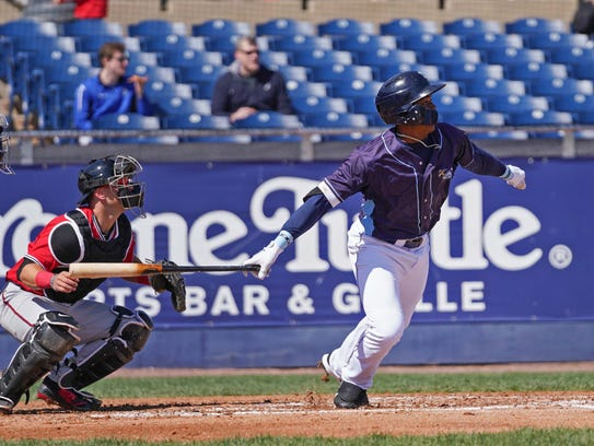 Wilmington Blue Rocks outfielder Khalil Lee watches the ball as he starts to run to first base Wednesday.