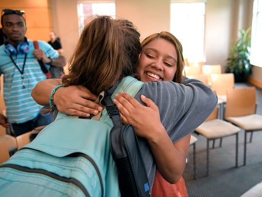 Lipscomb University student Katherine Climaco is hugged by another Lipscomb University student after Climaco spoke during a DACA informational meeting at the school's chapel on Thursday, Sept. 7, 2017. Climaco is one of 35 DACA students at Lipscomb University.
