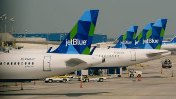 Jet Blue planes at New  York's JFK Airport on June 11, 2015.