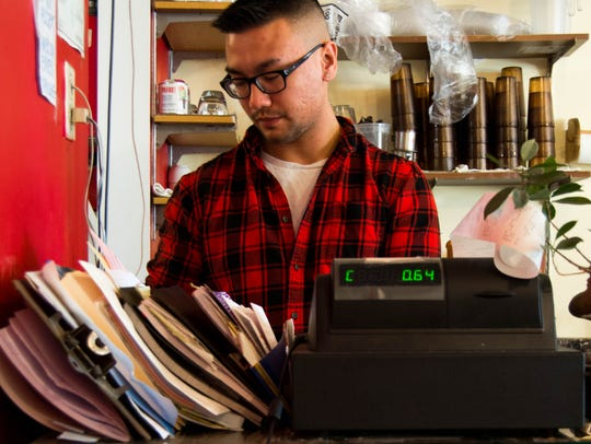 Kevin Pham works the register at Pho Dang in Winooski.