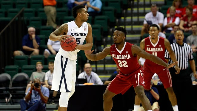 Nov 26, 2015; Lake Buena Vista, FL, USA; Xavier Musketeers guard Trevon Bluiett (5) drives to the basket as Alabama Crimson Tide guard Retin Obasohan (32) defends during the first half at ESPN Wide World of Sports Complex.