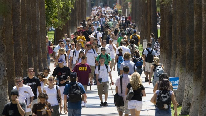 ASU students crowd onto Palm Walk on the first day of the fall semester at Arizona State University, Monday, August 21, 2006, in Tempe.