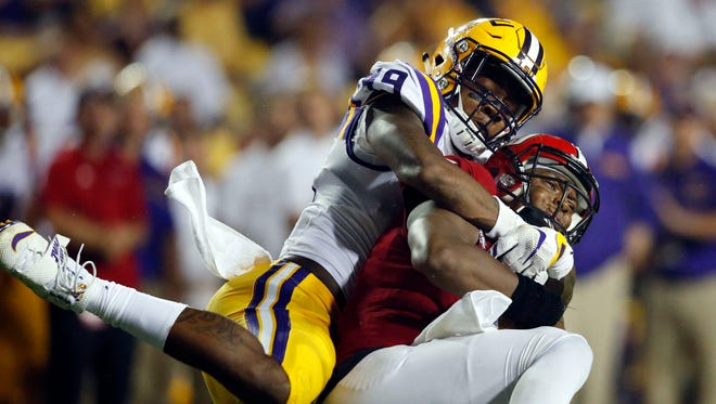 LSU defensive end Arden Key sacks Jacksonville State quarterback Eli Jenkins.