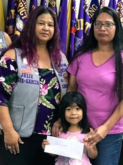 The Guam Sunshine Lions Club, in its mission of Caring for the Sick and the Elderly,  made a monetary donation to Mikayla Cruz, 5, to help defray the expenses of her medical treatment, on March 20, during the club's general membership meeting. Shown with Cruz are Lion Julie Garcia, sponsor, and Denise Santos.