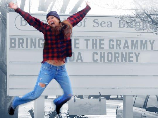 Linda Chorney jumps for joy in Sea Bright.