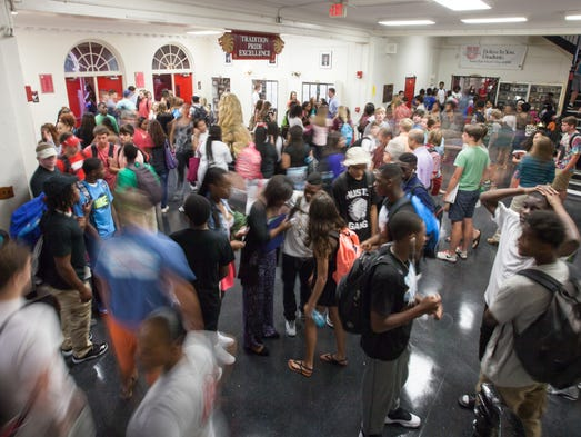 Students socialize and find their way to class before the start of the first day of school at Leon High School on Monday, August 18, 2014 in Tallahassee, Fla.