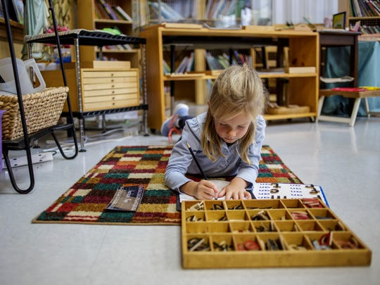 Anastasia Kapa, 5, works on a spelling lesson during a montessori kindergarten class Friday, Oct. 21, 2016 at St. Mary's Catholic School in St. Clair. The school is celebrating its 110th anniversary.