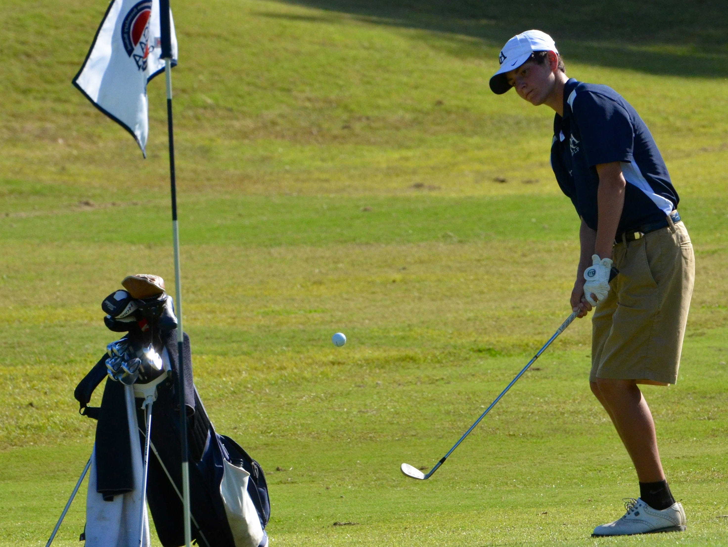 FRA's Josh Holtschlag attempts a chip on hold No. 18.