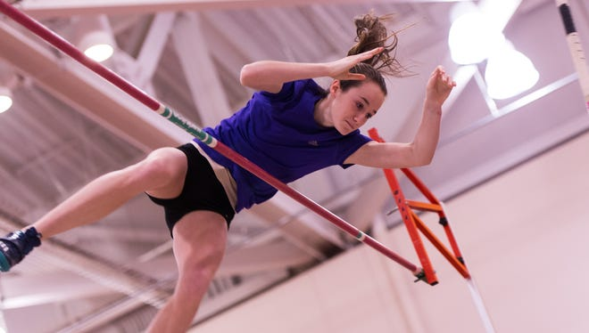 Erica Ellis of Gates Chili clears the bar to set a new New York State record for a freshman vaulter.