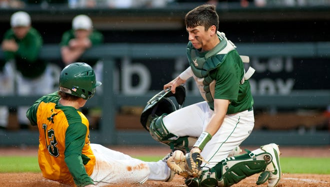 A pick-off attempt throw by Trinity 2nd baseman Dylan Byerly to Trinity 3rd baseman Hunter David results in an overthrow. St. Xavier's Brandon Tucker then heads for home where Trinity catcher Ben Metzinger is too late to make the play. The run gave St. Xavier a 4-0 lead.17 April 2017