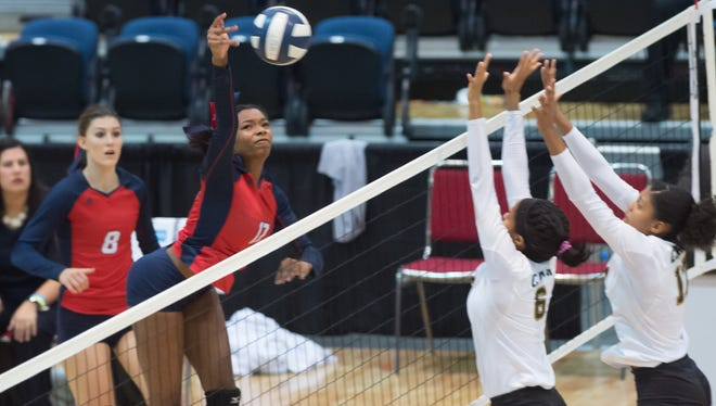Rebels middle blocker Tyler Alcorn gets the kill as the Teurlings Catholic Rebels beat Cabrini to win their 5th consecutive state title. Saturday, Nov. 11, 2017.