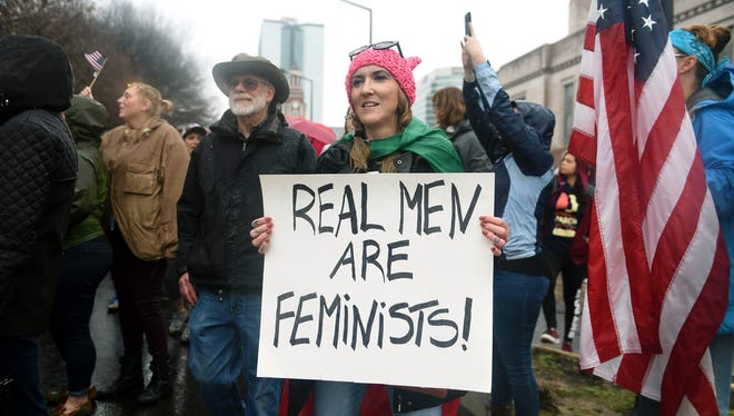 Marchers turn the corner Jan. 21, 2017, onto Locust Street in downtown Knoxville, Tenn.,  during the Women's March. More than 2,000 participated in the march despite rain.