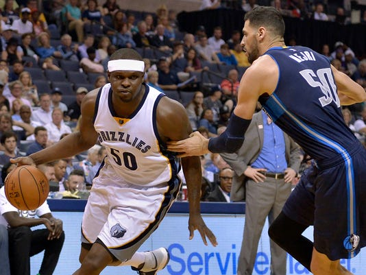 Memphis Grizzlies forward Zach Randolph, left, drives against Dallas Mavericks center Salah Mejri, right, in the second half of an NBA basketball game Wednesday, April 12, 2017, in Memphis, Tenn. (AP Photo/Brandon Dill)