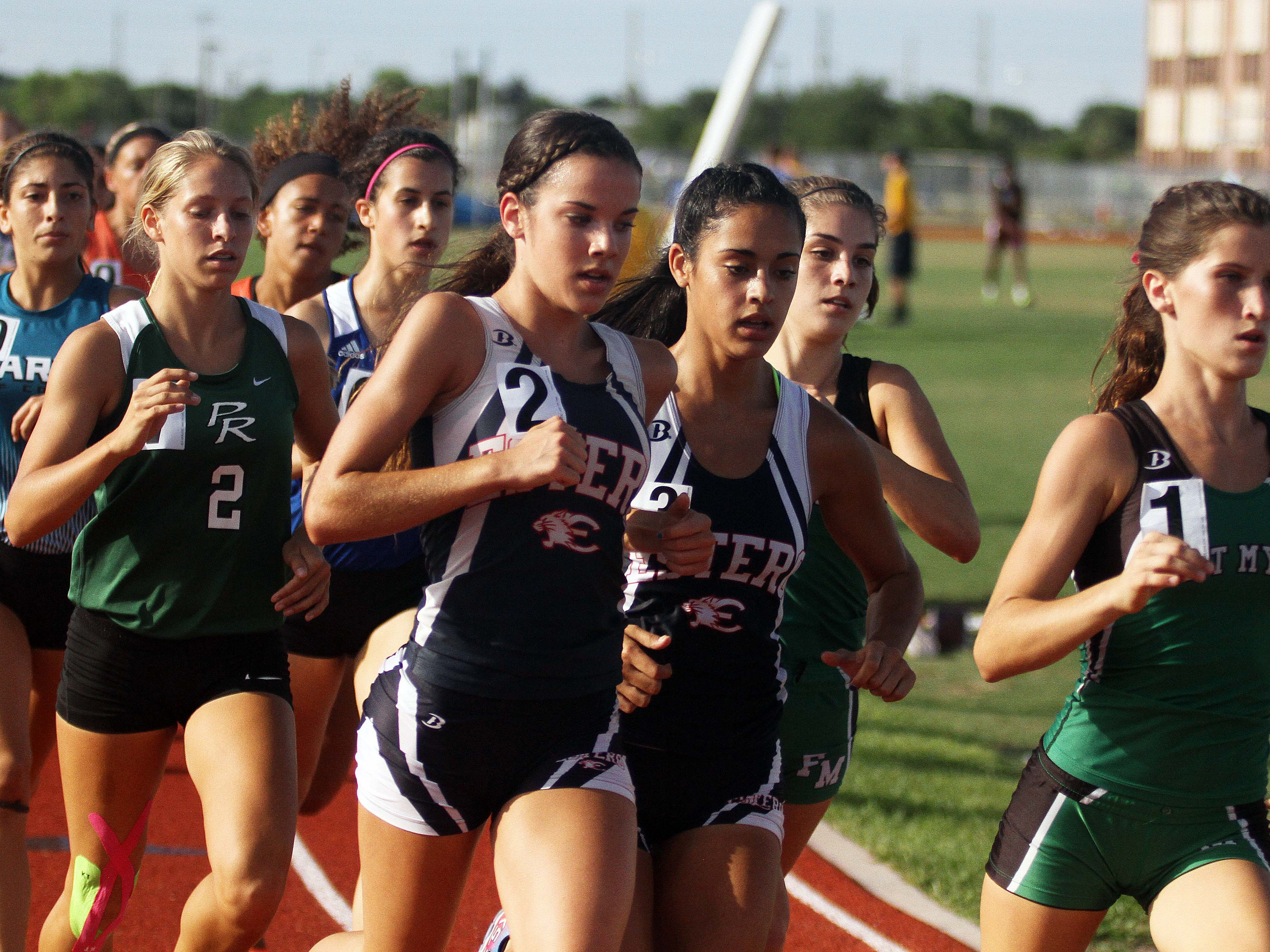 Fort Myers' Kristlin Gear, right, leads the pack during the girls' 1,600-meter run Thursday at the Region 3A-3 track meet at Charlotte High School. Gear won the race in 5:12.04.