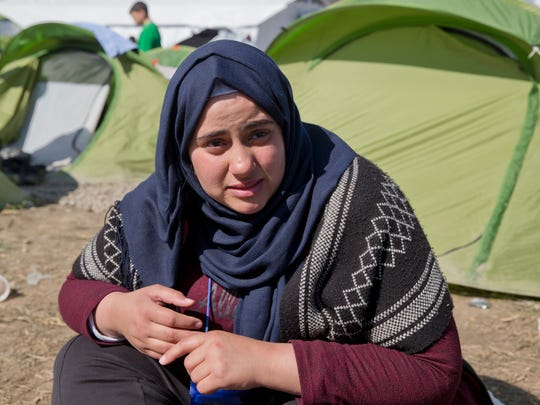"""Hala Haddad, left, a 19-year-old English literature student from Syria's now pulverized city of Homs sits at a camp in Idomeni, northern Greece, on the border with Macedonia, Thursday, March 3, 2016.  Speaking about the refugee camp Hala Haddad says """"The only thing that's here is desperation and misery.""""  The fields on the outskirts of the small Greek village of Idomeni have become the flashpoint in Europe's massive refugee crisis, the size of which the continent has not seen since World War II."""