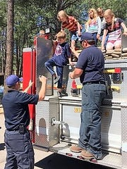 Before the egg hunt last year, children explored a fire engine.