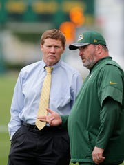 Green Bay Packers President & CEO Mark Murphy (left) and head coach Mike McCarthy talk during practice at minicamp on Tuesday, June 13, 2017, in Green Bay, Wis. 
