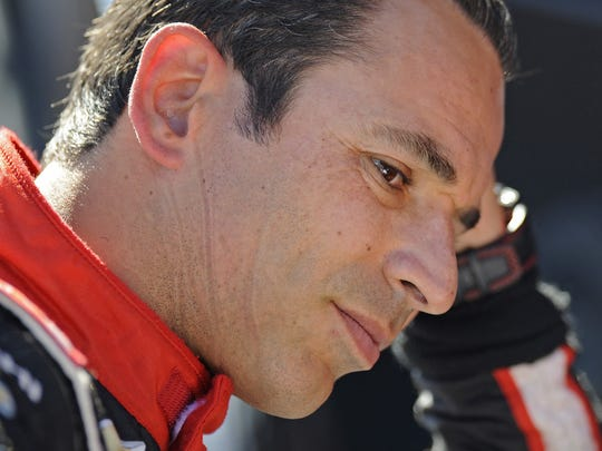 IndyCar driver Helio Castroneves sits in his pit box during a practice session for the Grand Prix of Sonoma at Sonoma Raceway in Sonoma, Calif., on Saturday, Aug. 23, 2014.