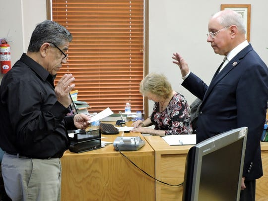 Esequiel Salas, at right, was sworn in as Mayor on March 9. At center is Municipal Clerk Cindy Varnhagen, whom Salas fired days later.