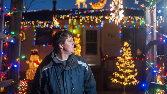 Jim Frahm stands outside his home in northeastern Great Falls, where he goes all out every year on his display.