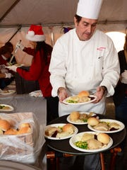 Chef Rich Pott prepares a Thanksgiving feast provided by Tim McLoone's charity, Holiday Express, at the Jersey Shore Rescue Mission in Asbury Park on Saturday.