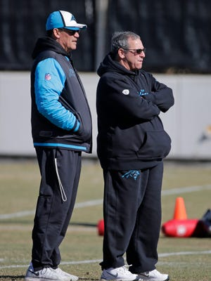 Carolina Panthers coach Ron Rivera, left, and general manager Dave Gettleman look on during practice Friday, Jan. 29, 2016, in Charlotte, N.C.