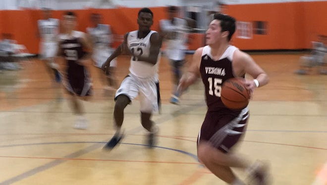 Senior Joey Zecchino (right) runs on a fast break after a steal against Christ the King.