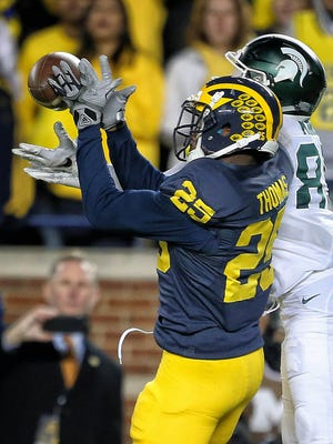 Oct 17, 2015; Michigan Wolverines safety Dymonte Thomas breaks up pass intended for Michigan State Spartans wide receiver Macgarrett Kings Jr. during the 2nd half at Michigan Stadium.