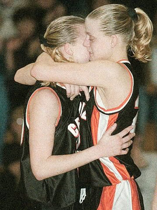 Kim McGhee is hugged by twin sister, Kris McGhee, after Kim scored her 1,000th career point in Central's 70-23 victory against William Penn in a District 3 Class AAAA semifinal March 1, 1999. Kris McGhee had cracked 1,000 points earlier in the season.