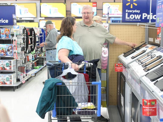 Shoppers discuss electronics at the Walmart Supercenter in Alamogordo late morning of Black Friday.