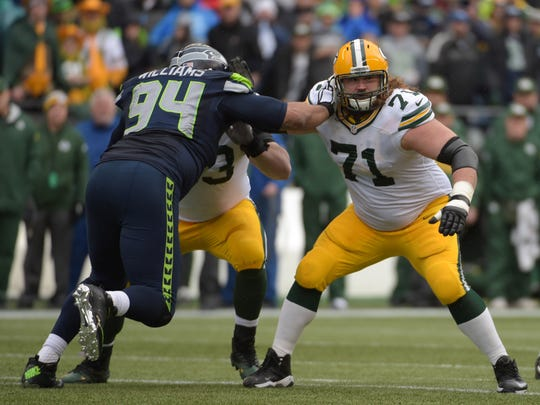 Green Bay Packers guard Josh Sitton (71) defends against Seattle Seahawks defensive tackle Kevin Williams (94) in the 2015 NFC Championship at CenturyLink Field in Seattle.