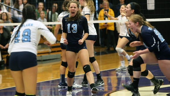 Westlake's Laine Peterson celebrates a point against
