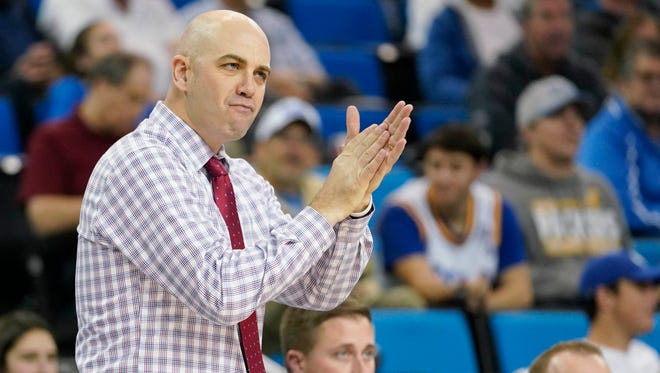 Craig Smith claps in encouragement of his South Dakota team during a Dec. 18 game at UCLA. Smith, a popular assistant coach at CSU under Tim Miles, was one of a handful of candidates who interviewed this week to become the Rams' next coach.