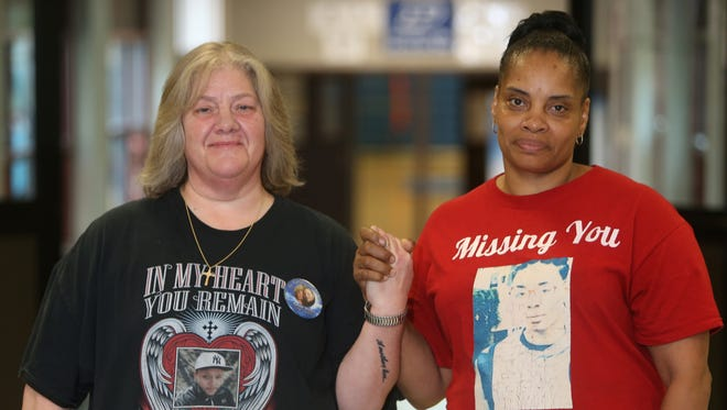 From left, Brenda Taddeo-Anderson and Cathis Johnson pose together at Poughkeepsie High School on Wednesday. Brenda's son, Ronny died in a May 2015 fire. Cathis' son, Caval Haylett was shot and killed in March 2016.