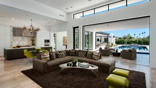 Custom homes, such as this single-level Bali-inspired property by Calvis Wyant Luxury Homes, is a cohesive collaboration of design and construction. It is customized to create welcoming interiors and unique outdoor spaces.