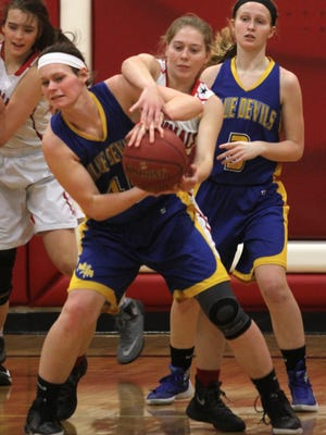 Martensdale-St. Marys senior Riley Verwers and Central Decatur junior Lily Simon fight for a rebound. Martensdale-St. Marys lost 53-28 to Class 2-A eighth-ranked Central Decatur in a Feb. 16 regional quarterfinal in Leon.
