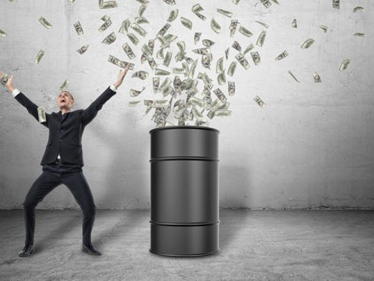 oil-barrel-and-money-falling-gettyimages-621693752_large.jpg
