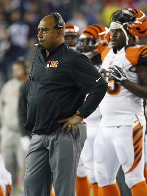 Cincinnati Bengals head coach Marvin Lewis watches after a fumble by wide receiver A.J. Green (18) in the second quarter against the New England Patriots at Gillette Stadium.