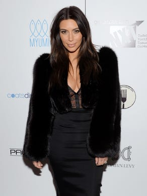 Flying solo, Kardashian attends a Generation NXT Dream Foundation benefit event on Feb. 16, 2014 in New York.