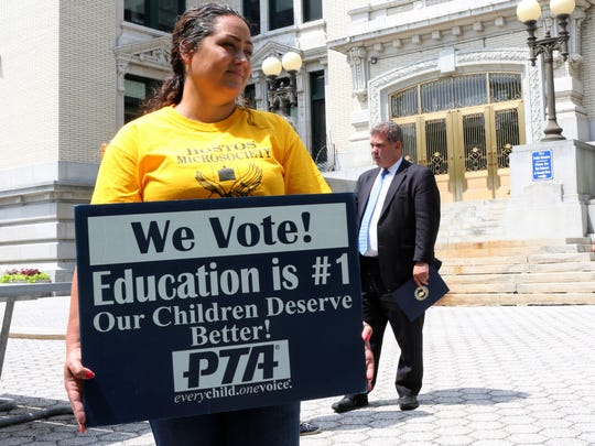 Yonkers resident and PTA member Brenda Cardoza at City Hall in June. Mayor Mike Spano is in the background.