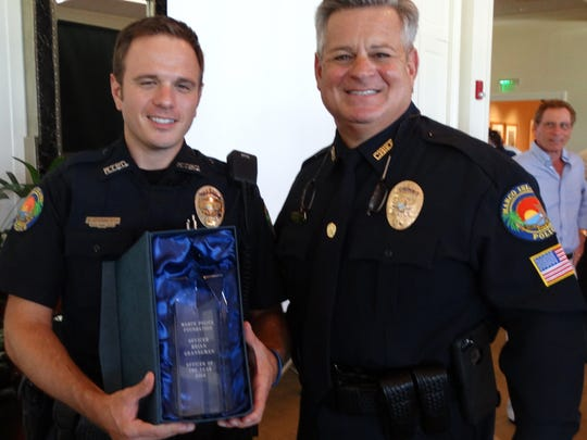 Former Marco Island police officer Brian Granneman, left, poses with then-Police Chief Al Schettino after being named officer of the year in 2015.