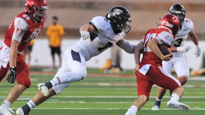 Stephenville's Colton Accomazzo (7) reaches to make a tackle during Friday's football season opener in Sweetwater.
